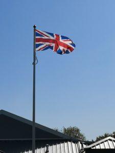 Union Jack flag flying on flagpole at Hartletts Park